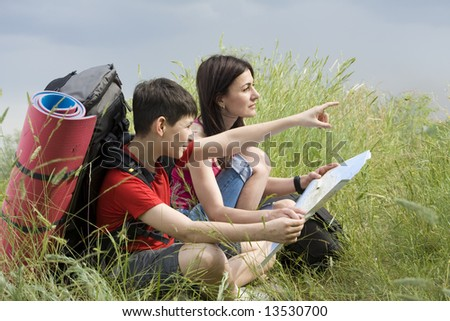 two hikers looking in the way - stock photo