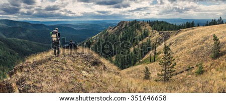 Two hikers traveling along the ridge on the southern Urals - stock photo