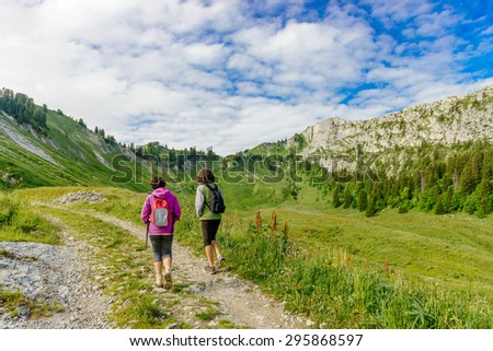 Two hikers women walking in the french Alps