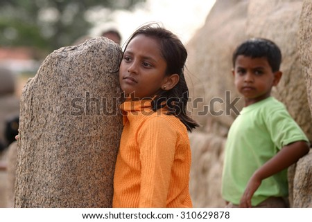 Two Hindu children watching tourists in the Shore Temple in India in 2005 Mamallipuram - stock photo