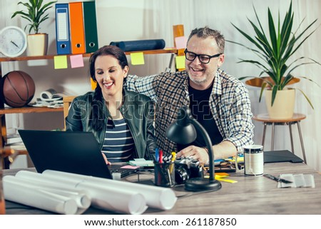 Two hipster managers working on laptop. Small Business Owner. Selective focus - stock photo