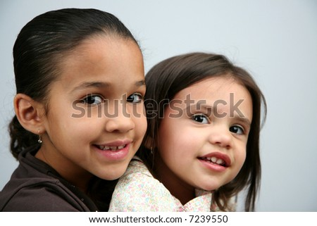 Two hispanic sisters sitting together