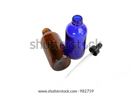 Two homeopathic medicine bottles and a dropper. - stock photo