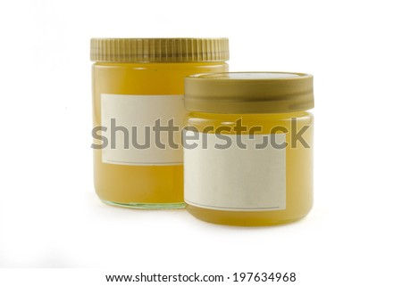 two Honey jars in front of white background - stock photo