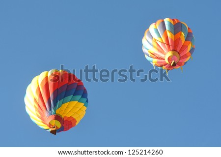 Two Hot Air Balloons competing in Reno Great Race - stock photo