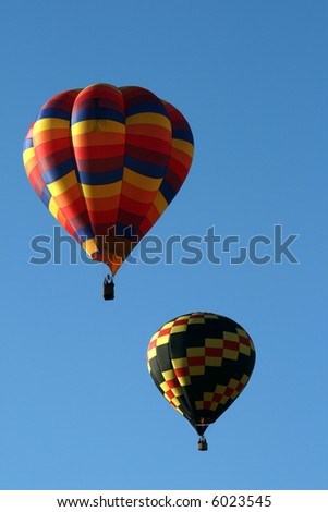 Two hot air balloons during an early morning ascend - stock photo