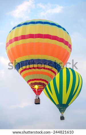 Two hot air balloons in the sky - stock photo