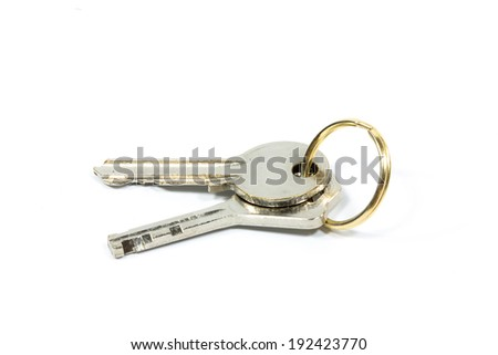 Two house keys on keyring isolated over white background