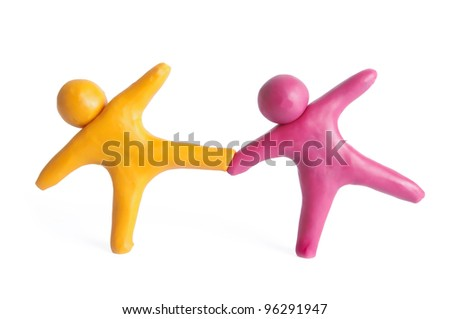 Two human figures from plasticine - stock photo
