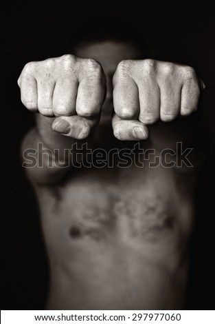 Two human fists. Aggression MANY OTHER PHOTOS FROM THIS SERIES IN MY PORTFOLIO. - stock photo