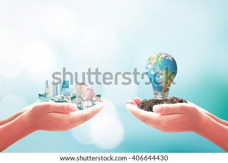 Two human hand hold beautiful big city & blue planet of lightbulb. Finance Learning CSR Team Bokeh Trust ROI Water Sea Hope Unity Idea Global Team concept. Elements of this image furnished by NASA. - stock photo