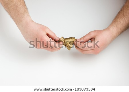 two human hands hold a water pipe on white background