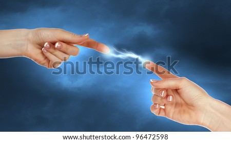 Two human hands in contact with bright flash