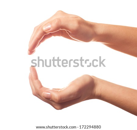 Two human hands showing sphere - stock photo