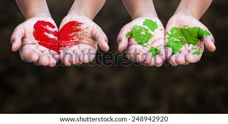 Two human painted red heart and green world map on hands. Ecology Environment Day Eco Friendly CSR Trust Love Food Help Healthy Health Care Valentine Earth Hour concept.