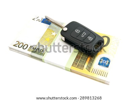 two hundred euros banknotes and car keys on white - stock photo