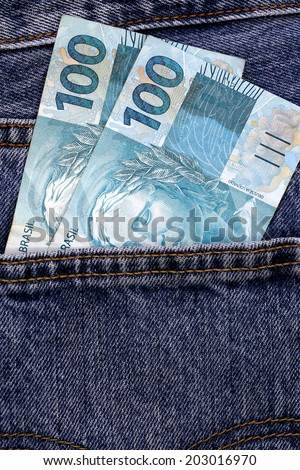 two hundred real, brazilian money, in jeans pocket - stock photo
