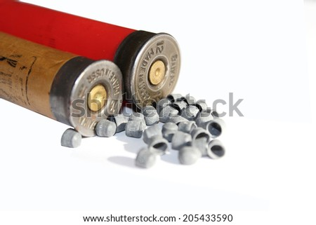 two hunt cartridges and many plumbeous fractions - stock photo