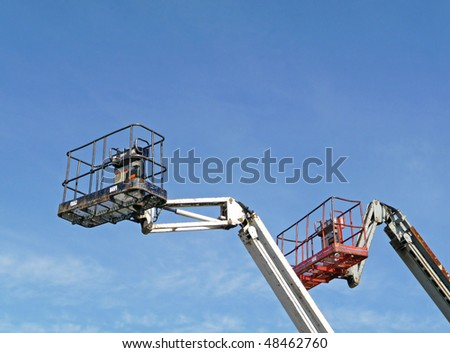 Two hydraulic lift platforms - stock photo