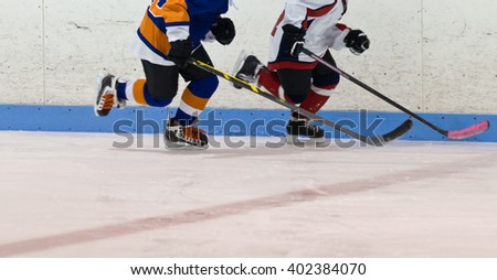 Two ice hockey player kids skating during a game - stock photo