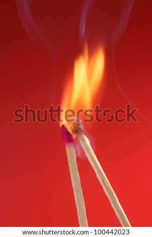 Two illuminated matches on the red