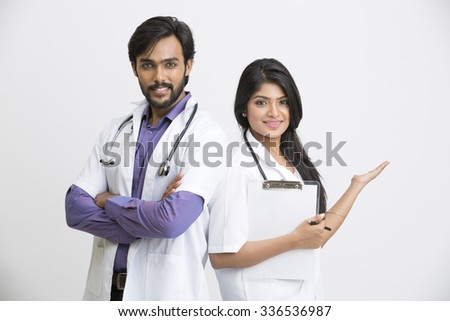 Two Indian young posing attractive doctors on white
