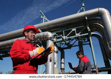 Two Industrial Engineers Working in a Factory.Industrial engineers work together. - stock photo