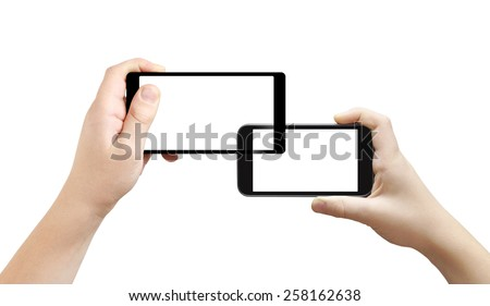 Two interweaved smartphones in hands, isolated, clipping path - stock photo