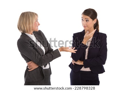 Two isolated businesswoman talking together: concept for body language. - stock photo