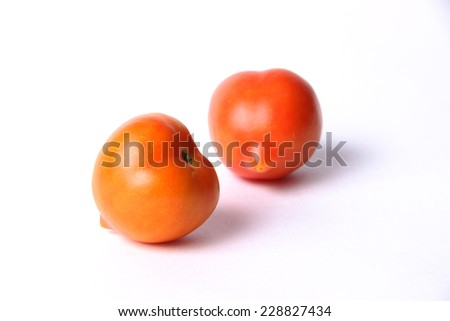 two isolated tomato on white background