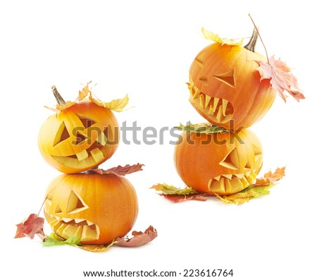 Two Jack-o'-lanterns orange pumpkin heads placed one over another and covered with colorful maple leaves, composition isolated over the white background, set of two foreshortenings - stock photo
