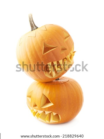 Two Jack-o'-lanterns orange pumpkin heads placed one over another, composition isolated over the white background - stock photo