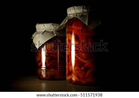 Two jars of apple jam closeup on a dark background