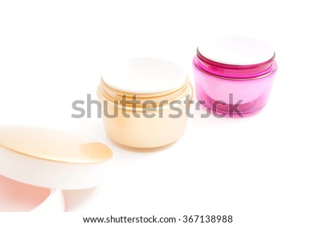 two jars of cream on white background closeup