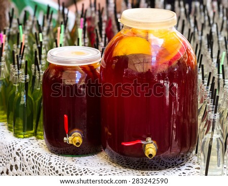Two jars of fruit compote with tap on the table