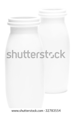 Two jars with milk over white
