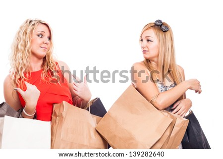 Two Jealous girls shopping and arguing, isolated on white background - stock photo