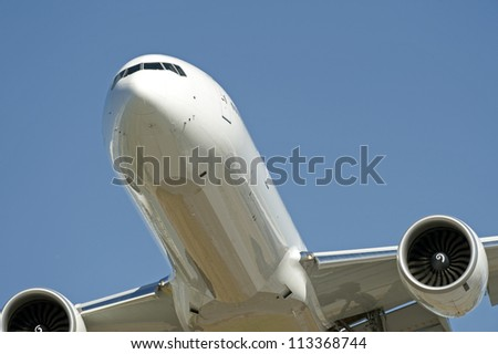 Two jet engine aircraft flying - stock photo