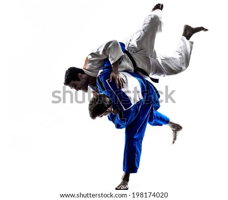 two judokas fighters fighting men in silhouette on white background - stock photo