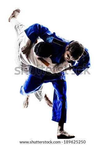 two judokas fighters fighting men in silhouettes on white background - stock photo