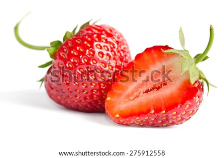 Two juicy ripe strawberries on a white background - stock photo