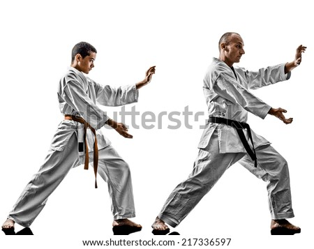 two karate men sensei and teenager student teacher teaching isolated on white background