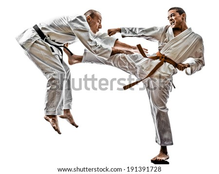 two karate men sensei and  teenager students fighters fighting isolated on white background