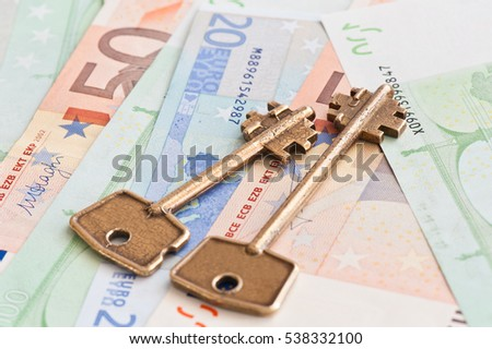 Two keys against money (100, 50, 20 euro banknotes) background