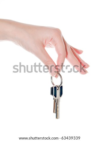 Two keys in a female hand. isolated on a white background