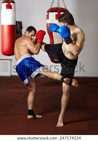 Two kickbox fighters training in the gym - stock photo