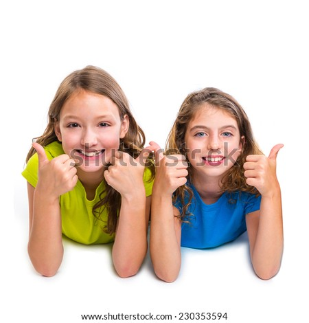 two kid girls happy ok thumbs up gesture expression lying on white background - stock photo