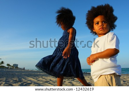 Two kids at the beach - stock photo