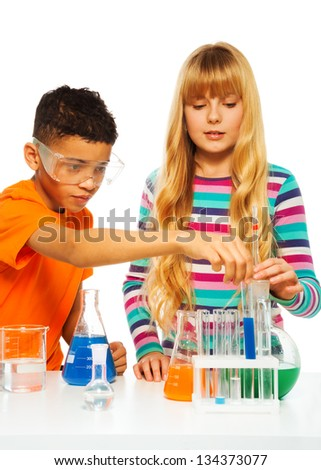 Two kids, black boy and blond girl in science chemistry class with test tubes and flasks, isolated on white