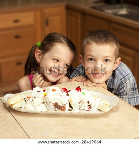 two kids excited about ice cream - stock photo